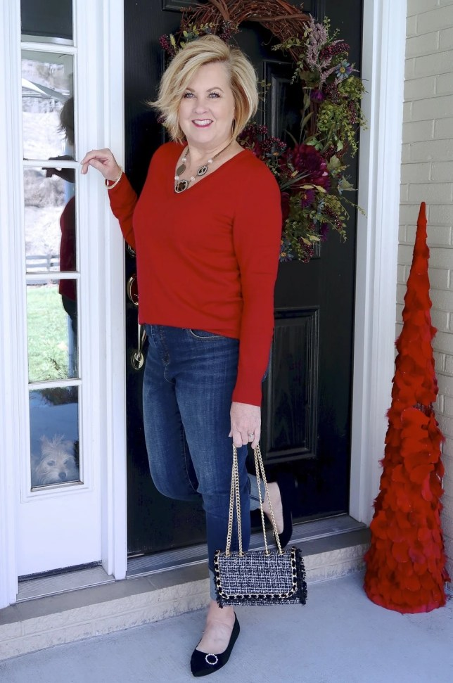 Jeans with a tweed cuff and a red v neck sweater worn by Fashion Blogger 50 Is Not Old