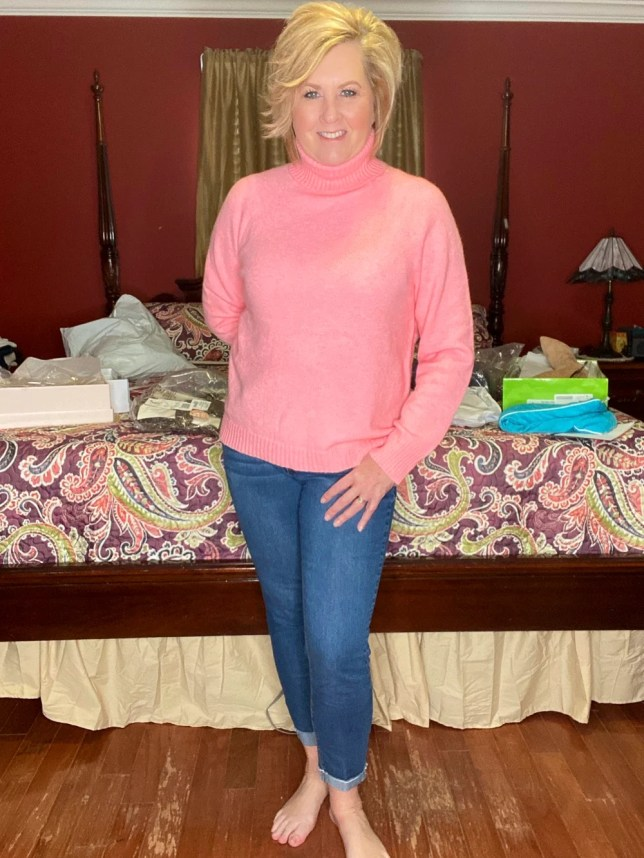 A pink turtleneck sweater from J Crew worn by fashion blogger 50 Is Not Old