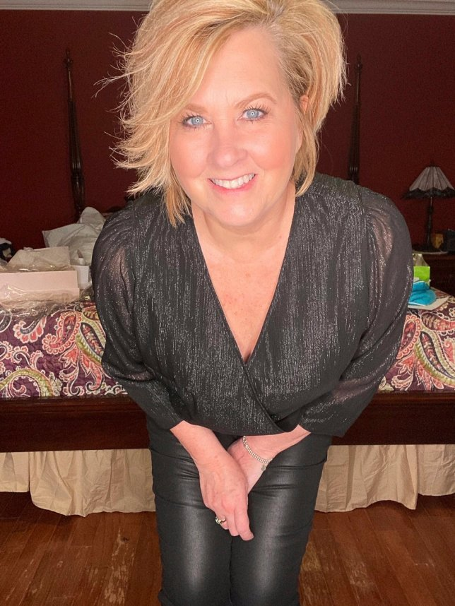 A black warp metallic top worn by fashion blogger 50 Is Not Old