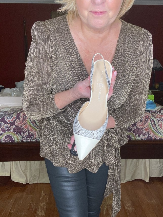 fashion blogger 50 Is Not Old showing a pair of snakeskin slingback shoes