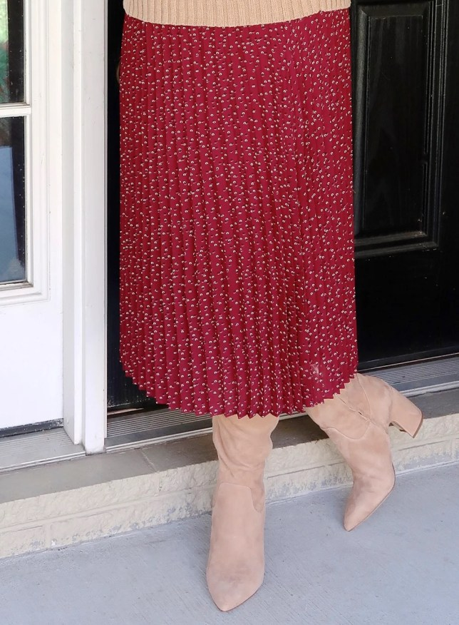 A burgundy skirt with knee boots by Vince Camuto worn by fashion blogger 50 Is Not Old