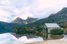 Stunning view of the boat shed on the shores of Dove Lake with Cradle Mountain as the backdrop.