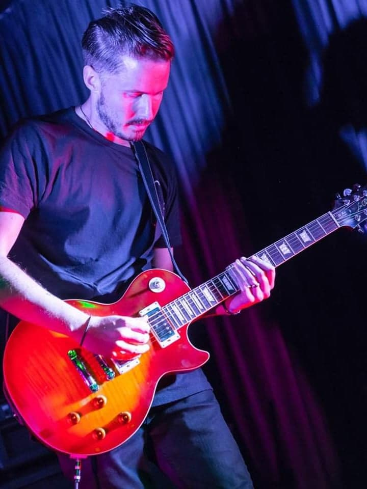 Andy Limn, guitarist for 50 Year Storm