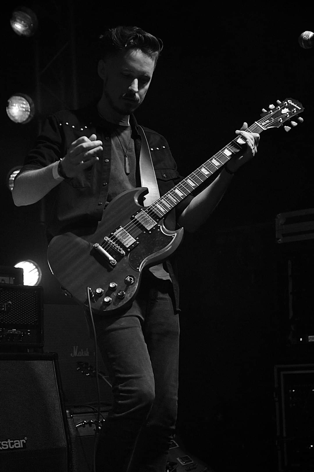 Andy playing guitar at Livewire
