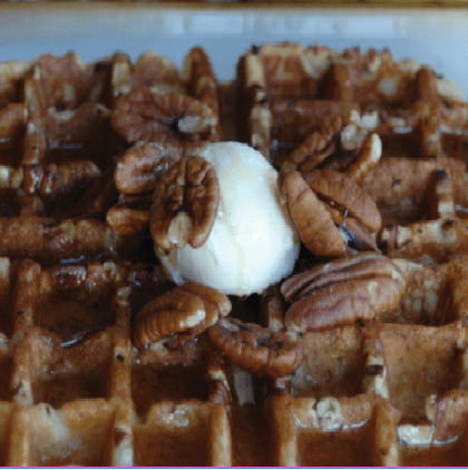 Waffles made from the homemade pancake mix with pecans and butter on top
