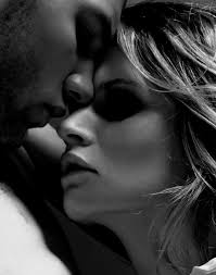 provocative pictures black and white of a man and a woman being sensual, his nose is on her forehead touching her nose with his lips while they stare
