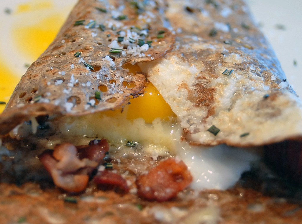 a galette folded with bacon and eggs