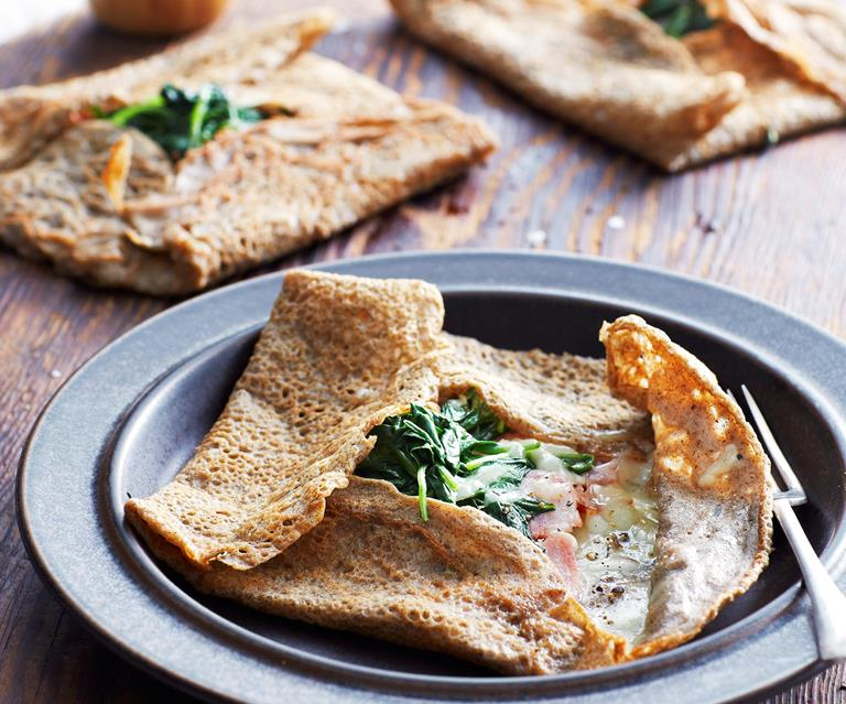 crepes with cheese and ham and spinach on a plate