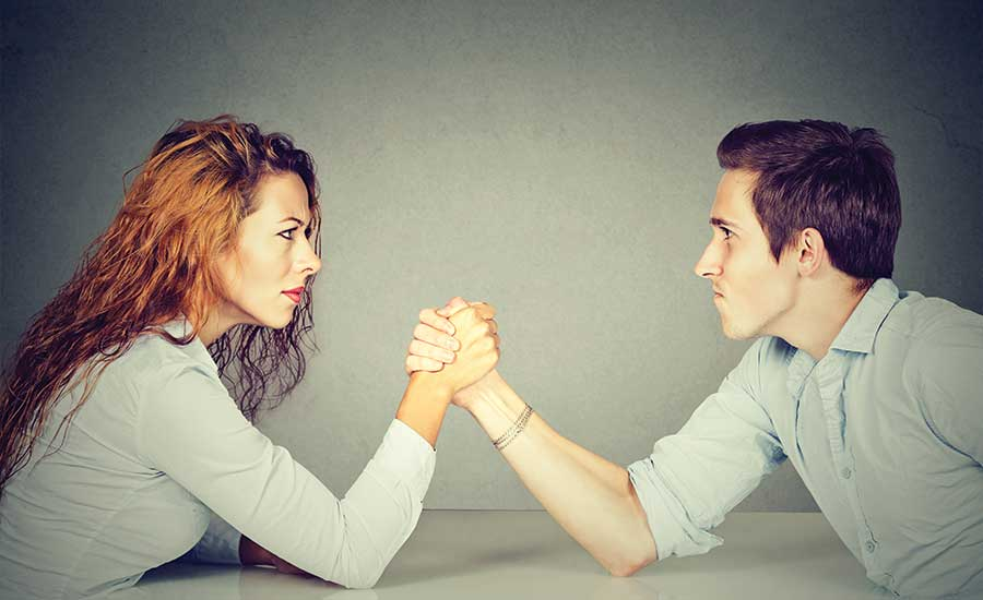 nothing sexier to a woman than a man who will help her. the man and woman are arm wrestling to see who does more of the work,
