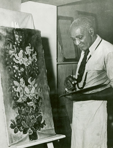 George Washington Carver painting a picture.