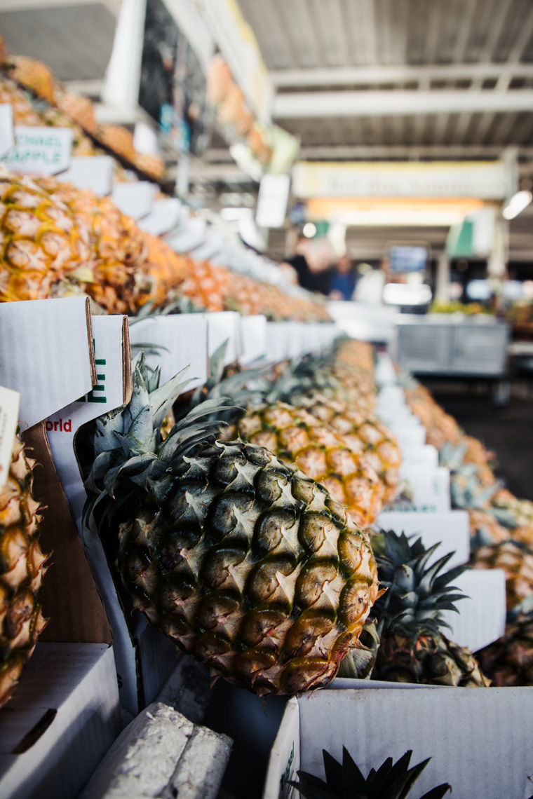 Row of pineapples at a market