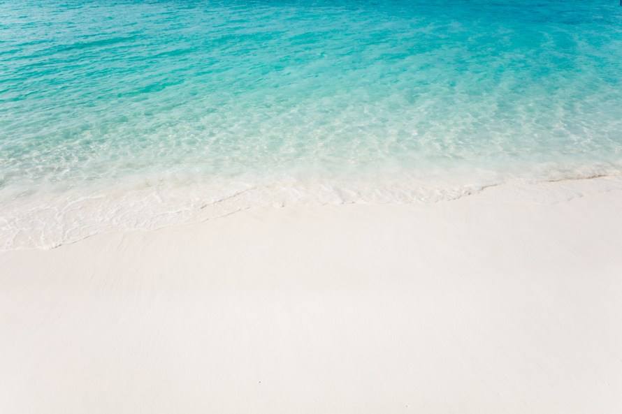 How to build airline miles - Ocean and sand