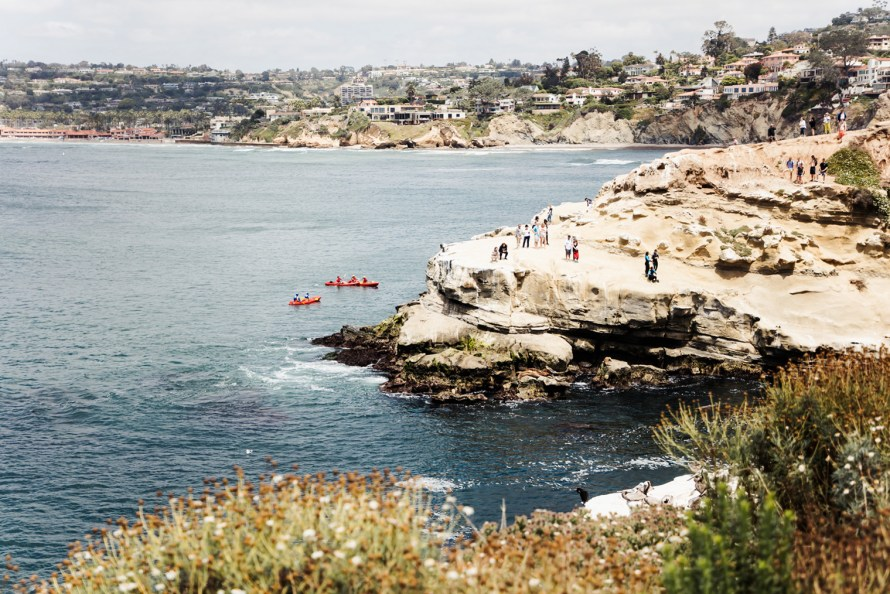 Rocky cliff and kayakers from above
