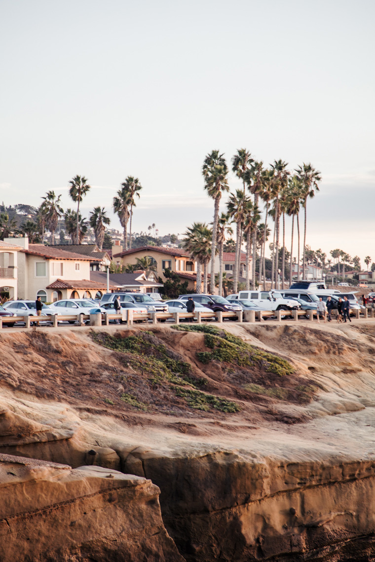 Cars parked by a cliff