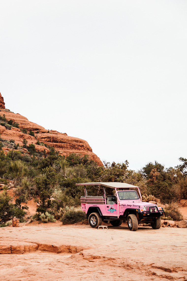 Pink jeep parked near Sedona red rocks