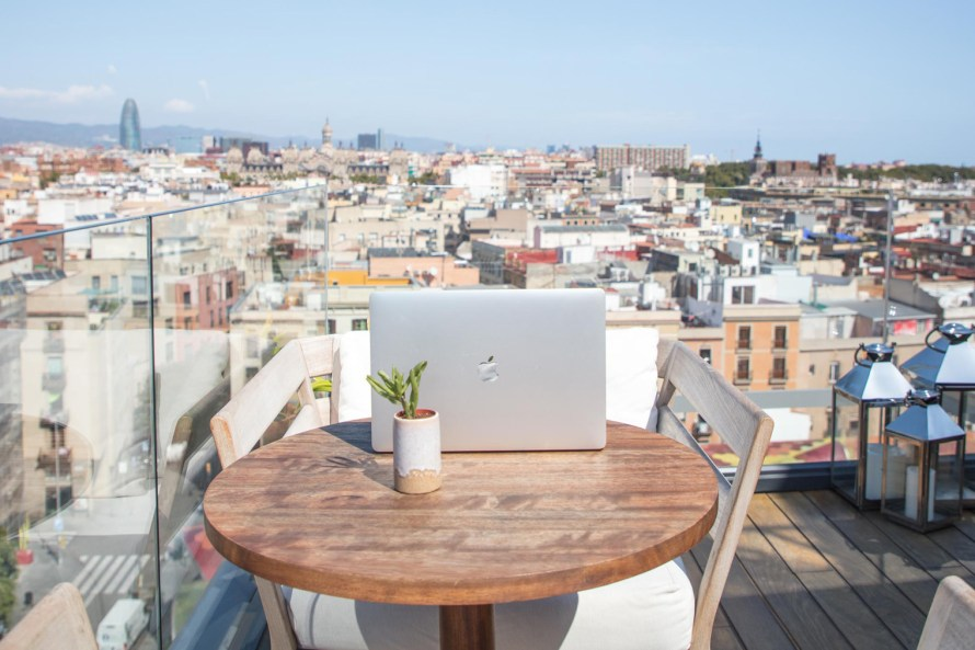 Laptop at rooftop bar