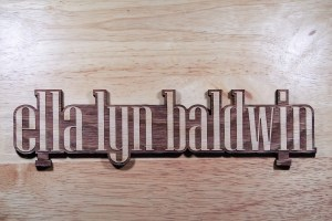 Ella Lyn Baldwin's name in wood