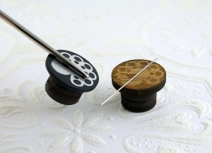 The bigger needle could lift the acrylic needle minders