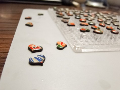 MDF glue board, with the Perler bead board on top.