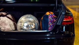 Black car at valet with disco ball in trunk - Best travel apps