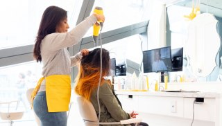 A woman getting a blowout at Drybar inside The Cosmopolitan of Las Vegas.
