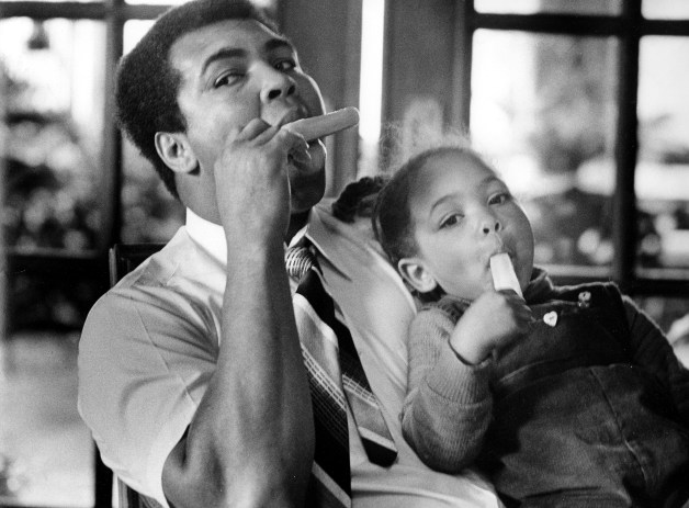 In Muhammad Ali's den, Hana, 3, shares a Popsicle with her father, who was handling the baby-sitting chores. Photo published Jan. 18, 1980. PUBLICATION PROHIBITED Authority to publish or copy MUST be obtained from Courier-Journal management. To obtain permission call 502-582-4601. 525 W. Broadway, Louisville, KY 40201. [Via MerlinFTP Drop]