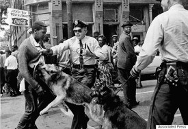 A 17 year old African American civil rights activist is attacked by police dogs during a demonstration in Birmingham, Ala., May 3, 1963. (AP Photo/Bill Hudson)