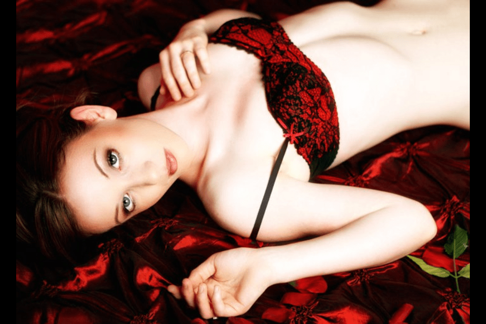GingerSnap90 on red satin sheets