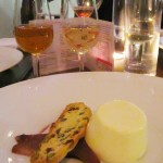 DOLCHFI E FORMAGGI: Amaretto panna cotta with red wine poached pears and homemade biscotti