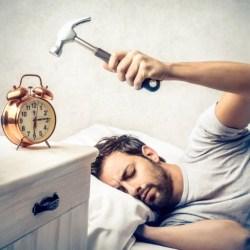 smashing the alarm clock!