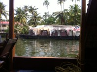 This is a picture of a houseboat taken from a houseboat.