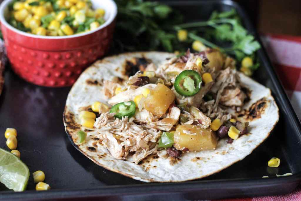 Easy Slow Cooker Hawaiian Chicken Tacos! Way better than drive thru tacos and better for you too. Will make these again for sure. | 5dinners1hour.com