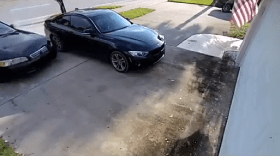 BMW almost hit by drifting car pulling up