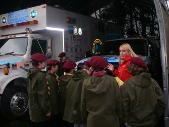 """The Scouts get up close with the team's fleet of specialized rescue vehicles nicknamed: """"Looking Glass"""", """"Batt Mobile"""", """"Mule Legger and """"Knuckles""""."""