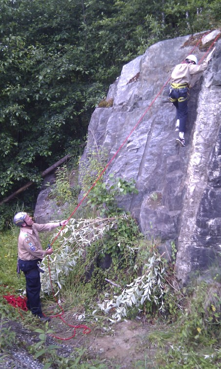 The boys have moved on to a slightly higher wall to learn top rope climbing. Here Scout Max easily scrambles up his first real rock wall. June 19, 2012.