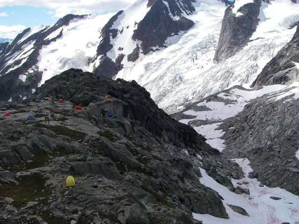 We pass the campsite at Applebee Dome (about 8,000 ft. and 1 km. from the Kain Hut) as we head up towards Eastpost Spire.
