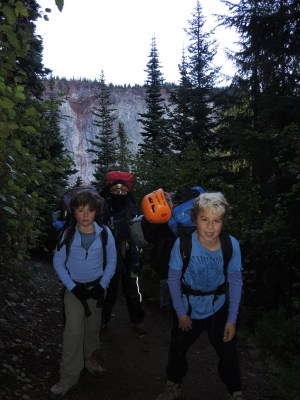 """With darkness falling (we had a late start to the day) we grab our headlamps and continue the hike to the campsite passing Garibaldi Provincial Park's famous """"Barrier"""" in the background."""