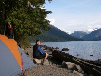 Scouter Alan takes a break to enjoy the view while the Scouts set up their tents and kitchens. The Spearhead Range, Singing Pass and Whistler Mountain are to his left and Garibaldi Park is to his right.