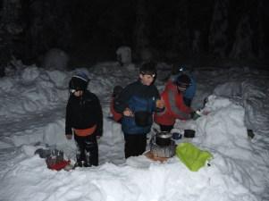 Happy campers preparing dinner.