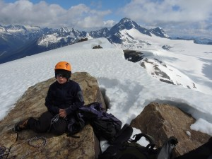 The big boy of Rogers Pass, Sir Donald (10,774'/3,284 m), rises just north of Youngs Peak behind Mountaineer Scout Keir.