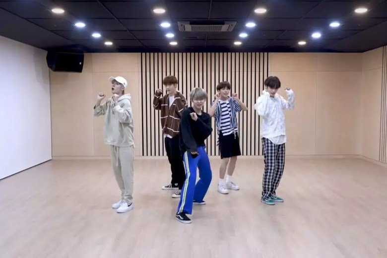"Watch: TXT Exudes Charm And Power In ""Cat & Dog"" Dance Practice Video"