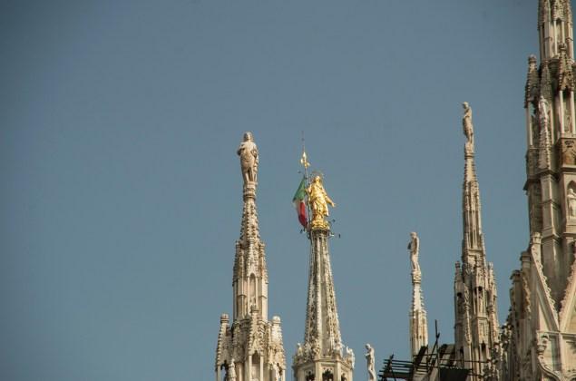 Golden statue atop Milans cathedral Duomo di Santa Maria Nascente.