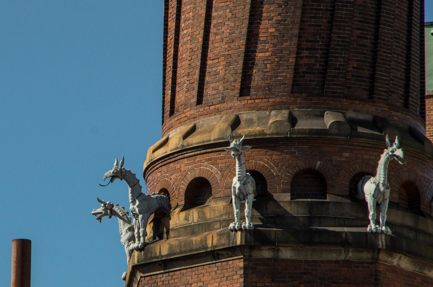Tiny dragon-horses on a giant chimney in Carlsberg