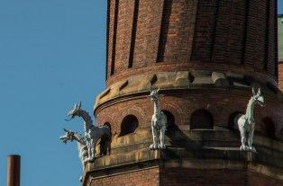 Tiny dragon-horses on a giant chimney in Carlsberg