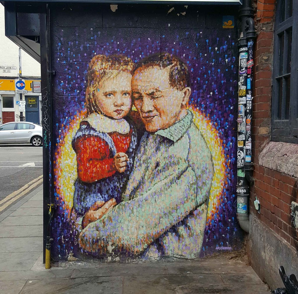 A man holding a small girl in his arms. Street Art by Jimmy C