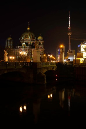 Illuminated Berlin cathedral with the tv tower in the background during Festival of Lights 2018
