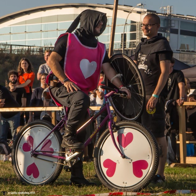 Cyclists with pink hearts all over at the Berlin Pedal Battle
