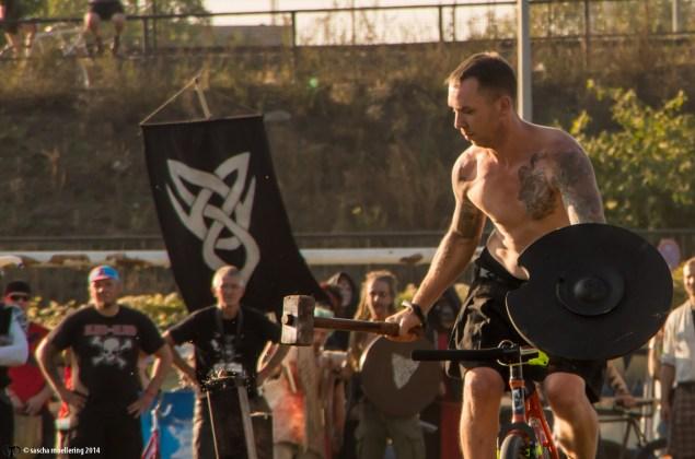 Berlin Pedal Battle, naked guy, tattoo, bike, hammer