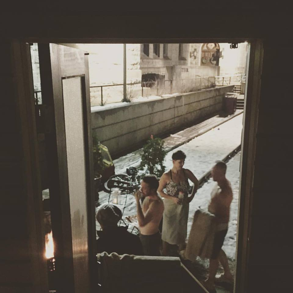 """View of the """"stoke yard"""" from Little Box Sauna interior."""