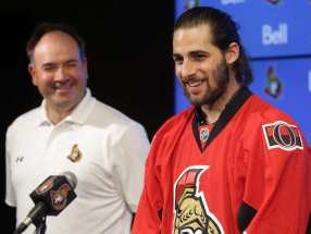 ottawa-senators-asst-gm-pierre-dorion-looks-on-as-eric-odell.jpg